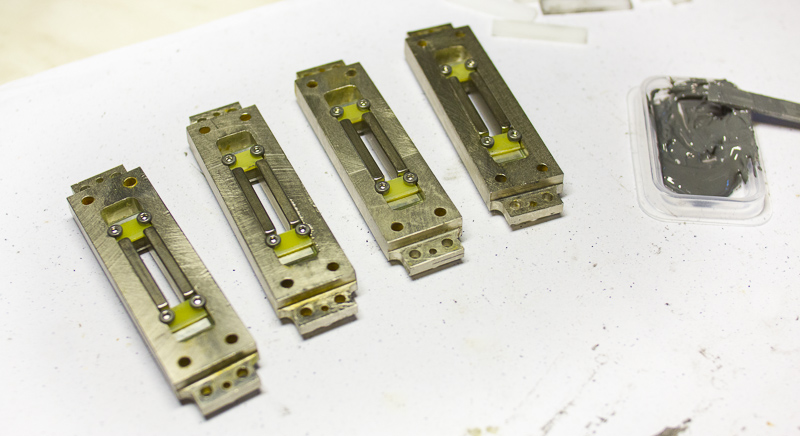 Four RE-323 Ribbon Microphone Motors being glued